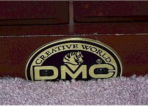 DMC logo plate