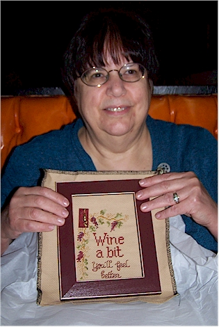 Carol with her wine stitch