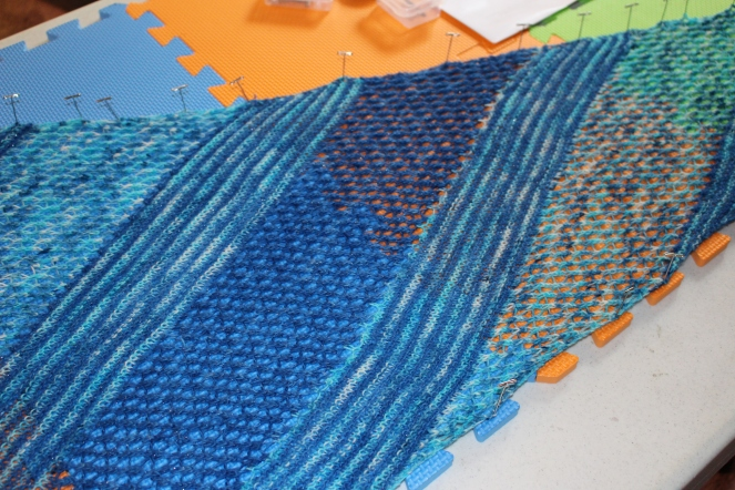 Seagrass shawl being blocked