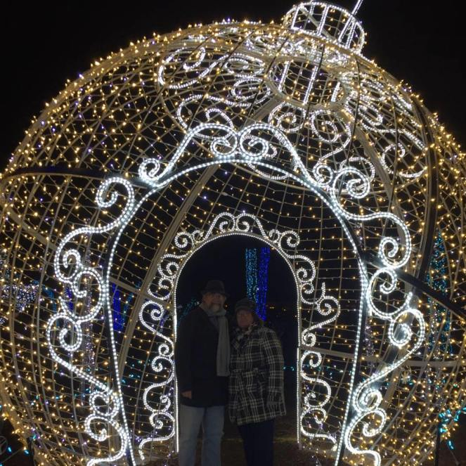 Us in a lighted Christmas ornament