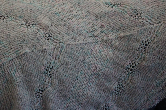 close up of feather shawl